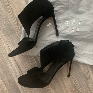 Gorgeous Stuart Weitzman cut-out black heels